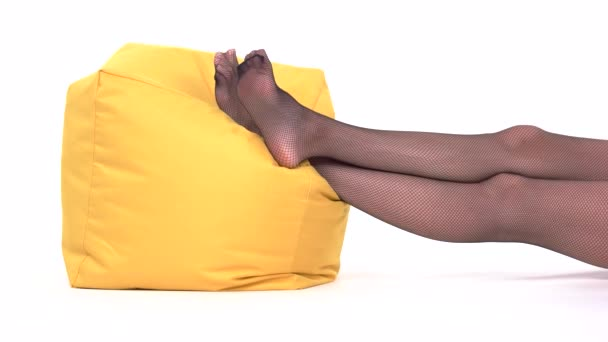 Feet lying on pillow.