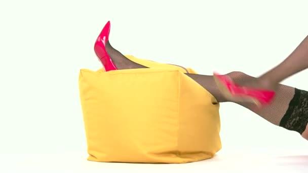 Legs in heels lying.