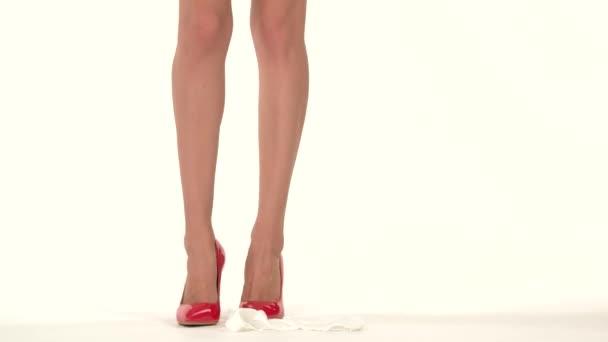 Bare legs in heel shoes.