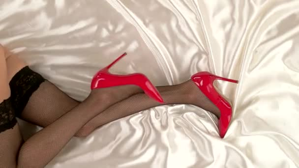 Legs in shoes and stockings.