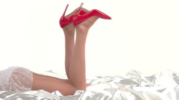 Womans legs in heels lying.