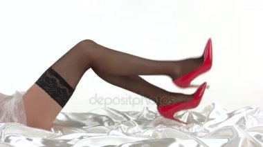 Ladys legs in red shoes.