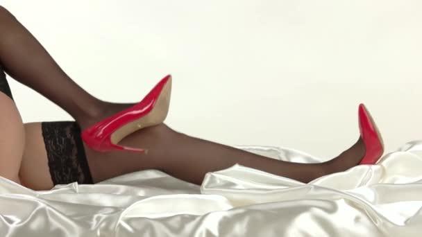 Legs with high heels lying.