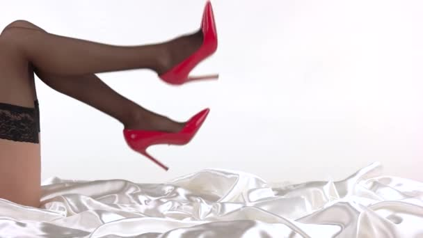 Legs in red heels.