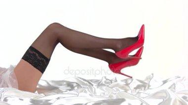 Legs wearing stockings and heels.