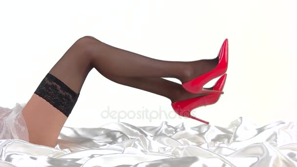 Legs wearing stockings and heels.