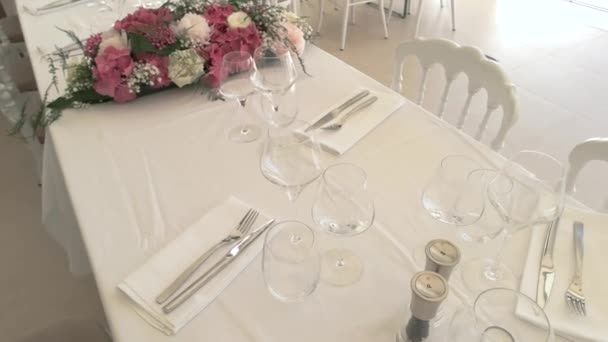 Wineglasses and cutlery on table.