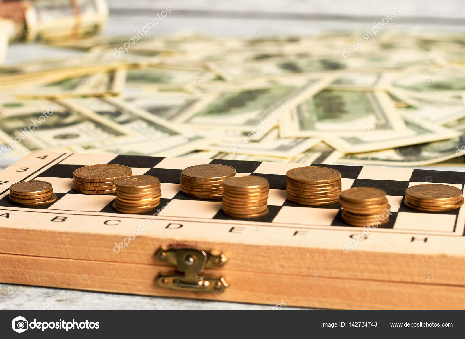 Coins On Chessboard And Dollars Stock Photo C Denisfilm 142734743