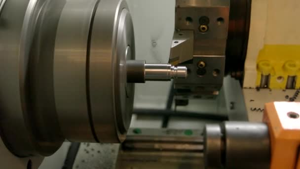 Metal turning lathe in action.