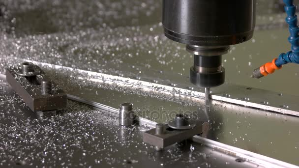 Metal milling machine in action.