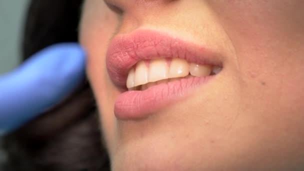 Smile of dental patient.
