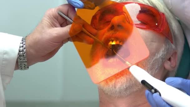 Stomatologist using curing light.