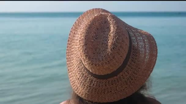 Lady in hat, sea background.