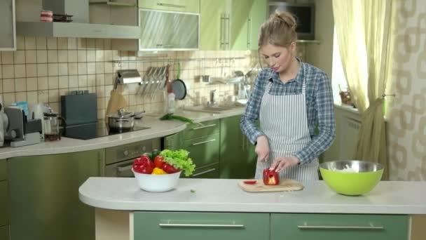 Woman cutting paprika.