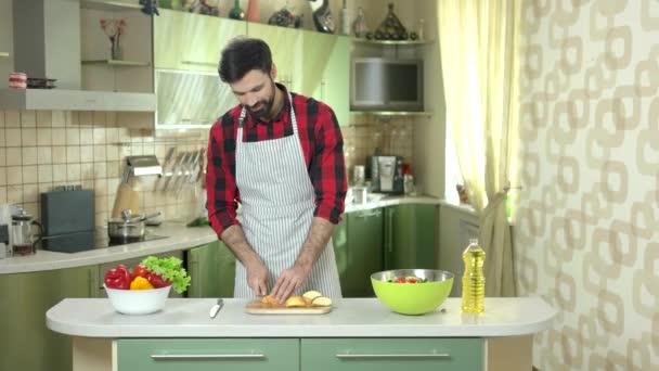 Man cuts apple.