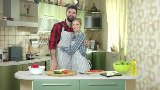 Happy couple in the kitchen.