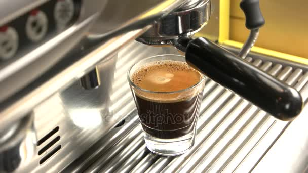 Coffee machine and espresso glass.