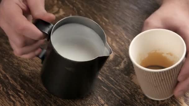 Hands making latte art flower.