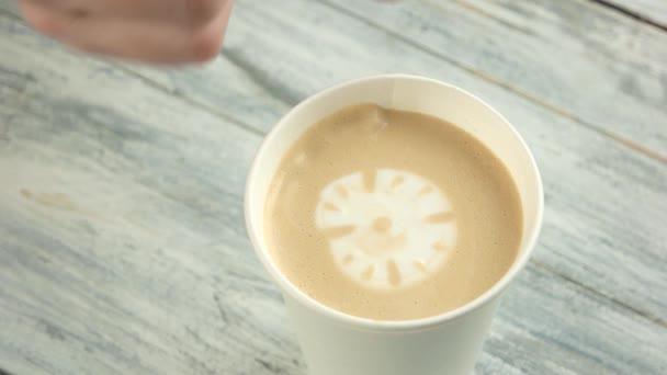 Hand making latte art clock.