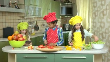 Three kids at cooking table.