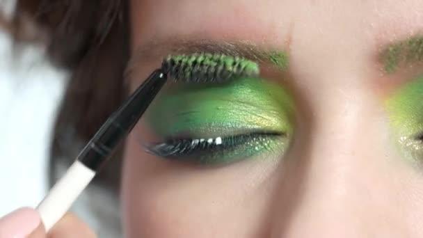 Brush applying makeup close up.