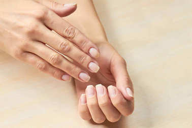 Female hands with clean nails.