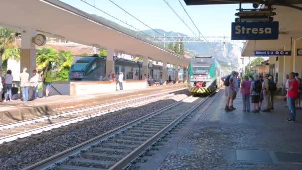 Passenger train arriving at platform.