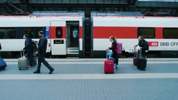 Train station, people with luggage.
