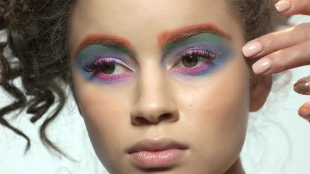 Eyeshadow applying, young model.