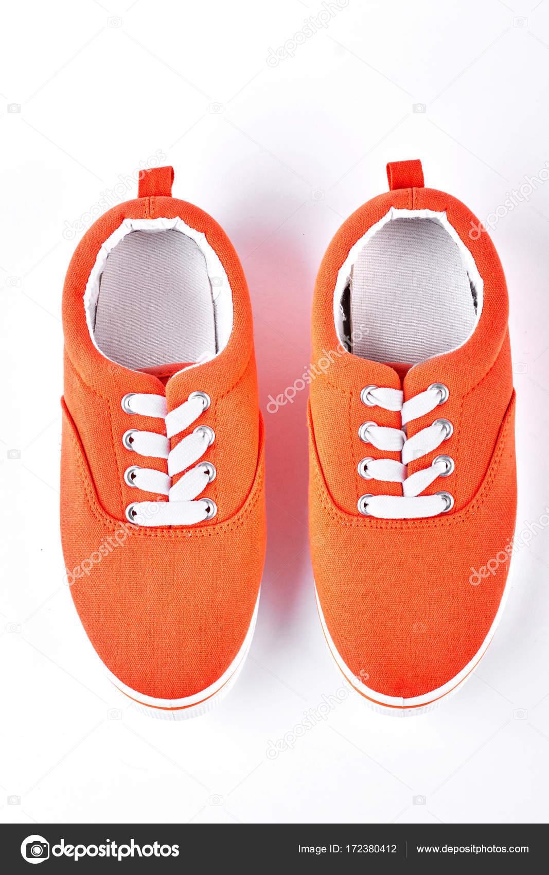 Weibliche orange vans, Ansicht von oben — Stockfoto © Denisfilm ...