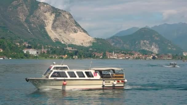 Tourist boat, mountains and sky.