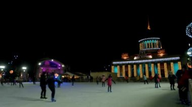 Skating on the open-air ice rink.