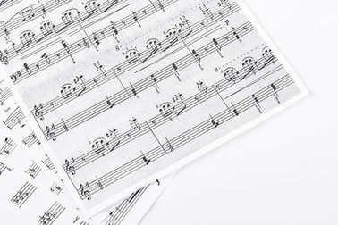 Music sheets on white background.