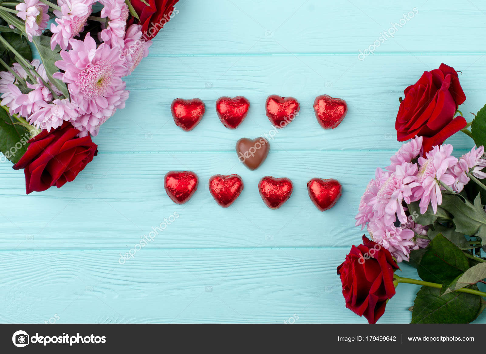 Beautiful flowers and heart shaped chocolate stock photo beautiful flowers and heart shaped chocolate valentines day flowers and chocolate hearts on wooden background top view happy valentines day izmirmasajfo Choice Image