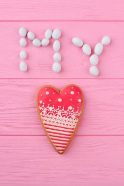 Valentines Day composition from sweets. Heart shaped cookie on pink wooden background. Valentines Day concept. stock vector