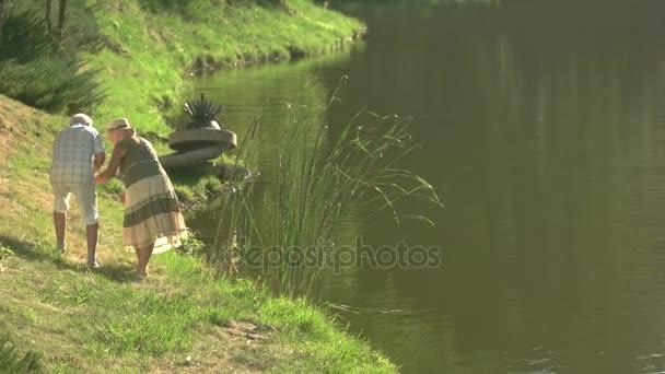 Romantic walk near river in sunny day.