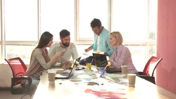Creative teamwork in office.