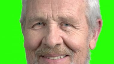 Close up face of old man, green screen.