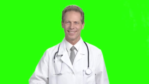 Smiling doctor with syringe, green screen.
