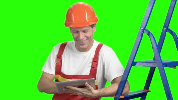 Happy manual worker with digital tablet.