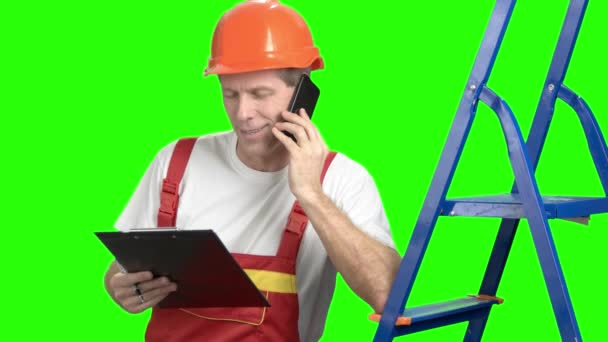 Architect talking on cell phone, green screen.