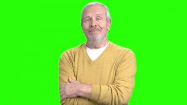 Elderly man having migraine, green screen.