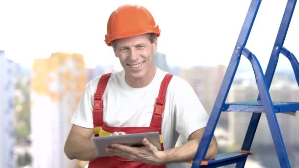 Positive architect working on pc tablet.