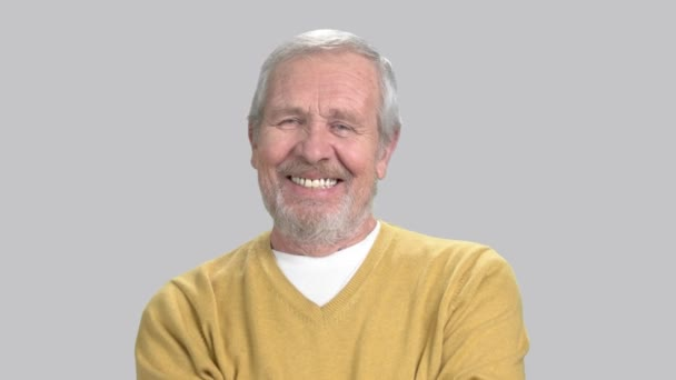 Smiling caucasian man on grey background.