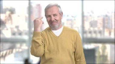 Mature man showing two fingers.