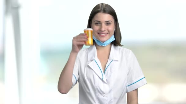 Young female doctor on blurred background.
