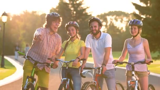 Cheerful group of young people with bicycles.