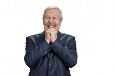 Senior business man laughing hard with folded hands.