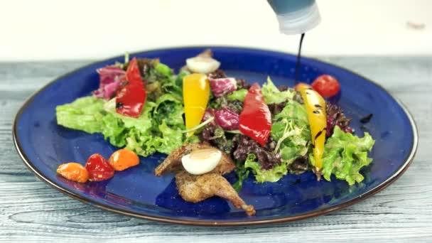 Tasty salad with sauce.