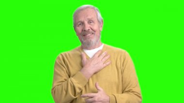 Talking mature man on green screen.